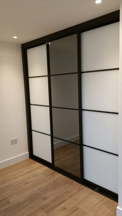 black an white with mirror in middle wardrobes