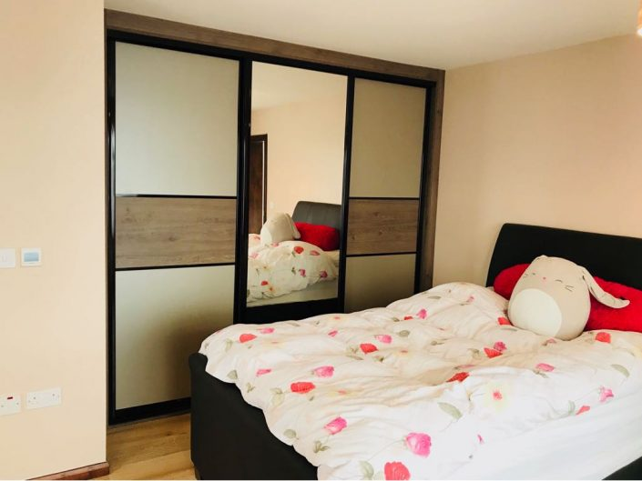 Sliding fitted furniutre with mirror.
