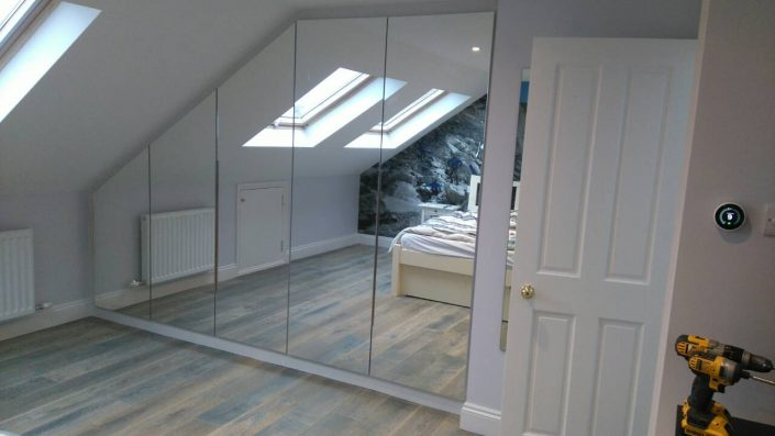 Loft conversion with mirror door